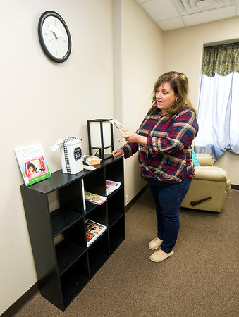 Lisa Williams, administrator for Webb City's YMCA Heritage Youth Development Center, displays some of the informational materials available to breastfeeding mothers inside the lacatation room at the center on Wednesday.<br /> Globe | Laurie Sisk