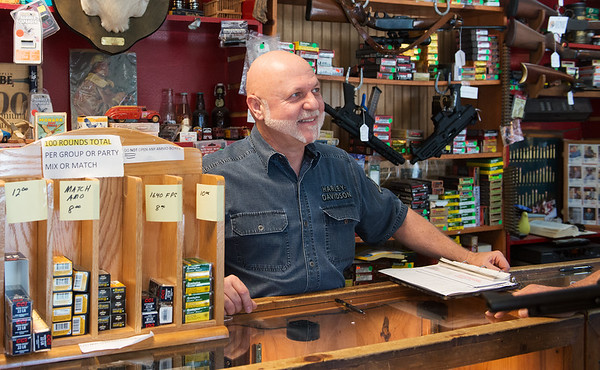Globe/Roger Nomer<br /> Brandon Spaugy helps a customer at Brandon's Gun Trading Company on Tuesday.