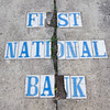 Letters remains on the sidewalk of the old First National Bank Building in Carterville on Friday. Brock Powell, of Powell's Construction and Flooring, plans to renovate the building into four large apartments, with retail space on the groundfloor.<br /> Globe | Laurie Sisk