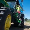 Globe/Roger Nomer<br /> Andrew Pogue, a Neosho Middle School fifth grader, exits a tractor after a ride on Thursday at the Neosho School Farm.