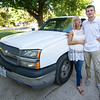 Jonathan Overman and his fiancee Fina Eaton, stand beside Fina's truck at their South Joplin home on Thursday. The couple, who met in drug court, say getting in trouble was the best thing that has happened to them. Fina is now licensed to drive.<br /> Globe | Laurie Sisk