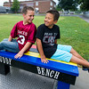"""From the left: Korbyn York, 10 and Dawson Little, 9, sit on the """"Buddy Bench"""" on Friday at Columbia Elementary. The bench, built by Columbia's principal Shally Lundien, was built to encourage inclusive interaction between children at recess.<br /> Globe 