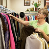 Globe/Roger Nomer<br /> Donna Bundy arranges clothing on Tuesday at New to Me Consignment.