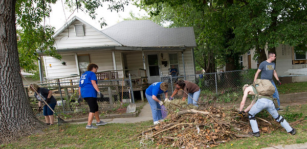 Some of the estimated 70 volunteers from Central City Christian Church help clean yards along South Sergeant during the Great Day of Service on Sunday. <br /> Globe | Laurie Sisk