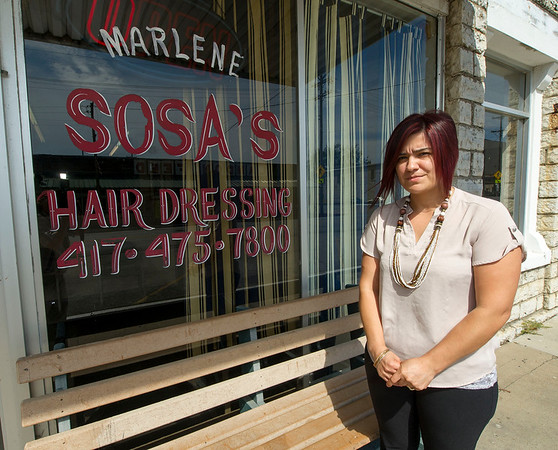 Small business owner Marlene Sosa stands outside her beauty salon, Marlene Sosa's Hair Dressing on Thursday in downtown Noel. Sosa said she cannot find a candidate she wishes to support.<br /> Globe | Laurie Sisk