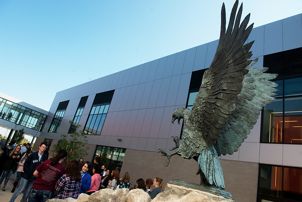 Globe/Roger Nomer<br /> The bronze eagle is unveiled on Wednesday in the Joplin High Rose Garden.