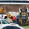 Crews work in pouring rain on Thursday morning as they repair a gas leak behind the Thomas E. Taylor Performing Arts Center at Missouri Southern.<br /> Globe | Laurie Sisk