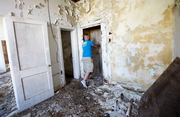 Brock Powell, of Powell's Construction and Flooring, stands near one of two safes inside the old First National Bank Building in Carterville on Friday. Powell plans to renovate the building into four large apartments, with retail space on the groundfloor.<br /> Globe | Laurie Sisk
