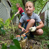 Seven-year-old Zachary Miller, of Central City Christian Church, trims small saplings on South Sergeant during the Great Day of Service on Sunday. Miller was one of about 70 members of the church who volunteered their services on Sunday.<br /> Globe | Laurie Sisk