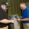 From the left: Pittsburg Memorial Auditorium Technical Director Jason Huffman and General Manager Jeff Wilbert move a decorated column in preparation for the Dowrtown Pittsburg Bridal Crawl, which takes place from 5:30 pm to 9 pm Friday at Pittsburg Memorial Audtitorium.<br /> Globe | Laurie Sisk