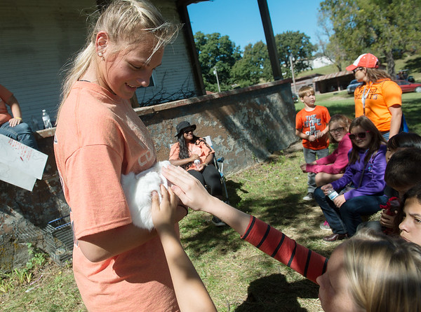 Globe/Roger Nomer<br /> Kaley Wheeler, a Neosho High School sophomore, shows a rabbit to Neosho Middle School students on Thursday at the Neosho School Farm.