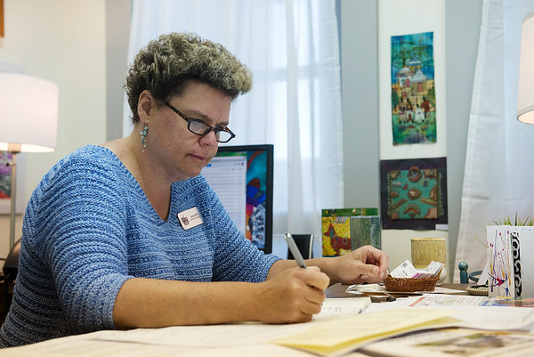 Globe/Roger Nomer<br /> Josie Mai, executive director at the Spiva Center for the Arts, works in her office on Thursday.