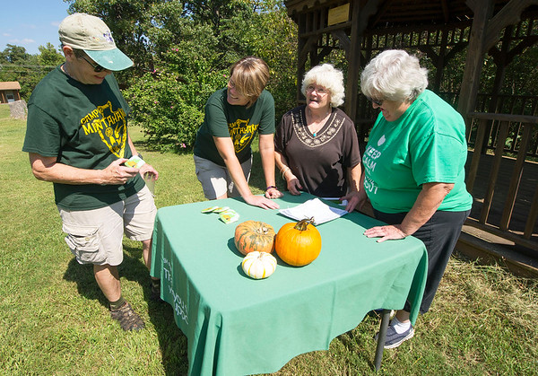 From the left: Camp Mintahama alumnae Judy Russell, of Pittsburg, Joyce Bush, of Lake of the Ozarks, Vicki Cassady, of Carl Junction and Mavis Bowen, of Columbus, prepare Friday to welcome guests at the Camp Mintahama Reunion Roundup, which takes place this weekend at the camp. <br /> Globe | Laurie Sisk