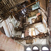 A photograph shows the collapsed second and third floors of the old First National Bank Building in Carterville on Friday. Brock Powell, of Powell's Construction and Flooring, plans to renovate the building into four large apartments, with retail space on the groundfloor.<br /> Globe | Laurie Sisk
