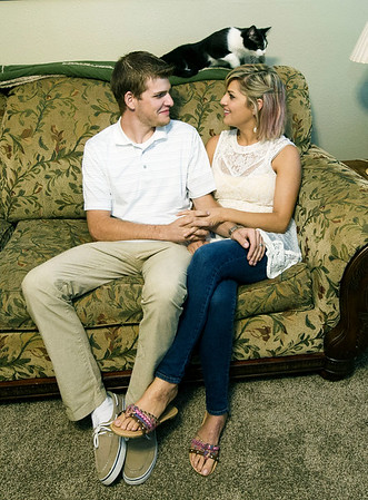 Jonathan Overman and his fiancee Fina Eaton, sit inside their South Joplin home on Thursday. The couple, who met in drug court, say getting in trouble was the best thing that has happened to them. The couple also are expecting their first child in April.<br /> Globe | Laurie Sisk