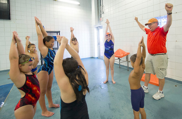 CatTracks swim coach Lyman Burr, right, stretches with his swimmers last week at the Fair Acres Family YMCA in CArthage.<br /> Globe | Laurie Sisk