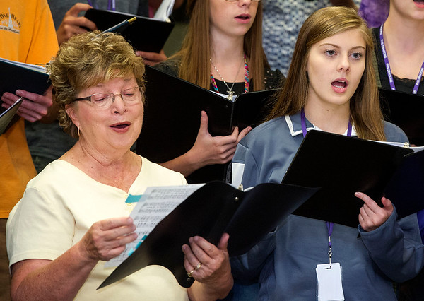 Lois Amershek, left and Aspen rehearse side-by-side with the Pittsburg Multi-generational Choir on Thursday at PHS. <br /> Globe | Laurie Sisk