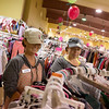 Globe/Roger Nomer<br /> Cassie Berryman, left, and Charity Barwick stock clothing on Monday at the Rhea Lana's Children's Consignment event at the Joplin Trade Center. The sale continues through Wednesday.