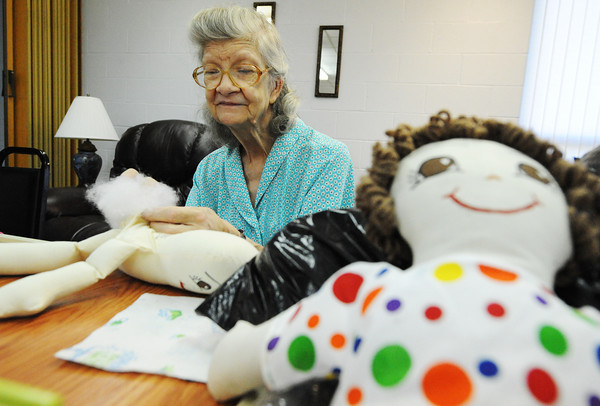 Globe/T. Rob Brown<br /> Rochelle Pruett, of Anderson, a longtime member of the Heartland Doll Club, sews another doll Saturday, Sept. 22, 2012, at the Joplin Senior Citizens Center. The group donates the dolls to area hospitals for children.