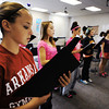 "Globe/T. Rob Brown<br /> Pittsburg (Kan.) Middle School eighth grader Olivia Joy, left, and the rest of her class practice a musical piece from Dr. Hubert Bird's ""The Other Side of Storm"" concert-narrative during Virginia Darling's music class Wednesday afternoon, Sept. 26, 2012."