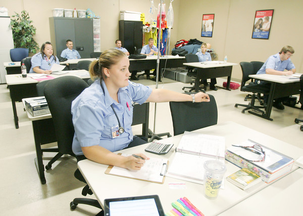 Globe/Roger Nomer<br /> Brenna Jones takes notes during a paramedic class at Crowder College on Thursday.