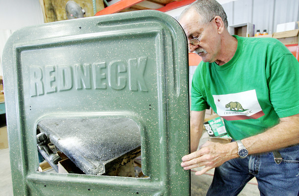 Globe/Roger Nomer<br /> Gayland McManis works on a door of a hunting blind at Redneck Blinds in Lamar on Tuesday.