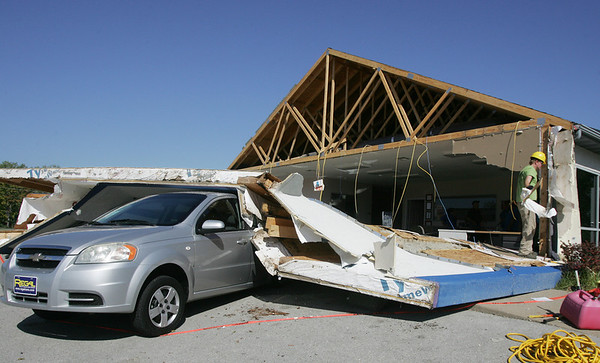 Globe/Roger Nomer<br /> Wednesday's microburst tore off the facade of Regal Car Sales at 7th and Ohio.