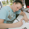 Globe/Roger Nomer<br /> Brittany Steever, a freshman from Joplin, fills out a voter registration form at Missouri Southern on Tuesday.