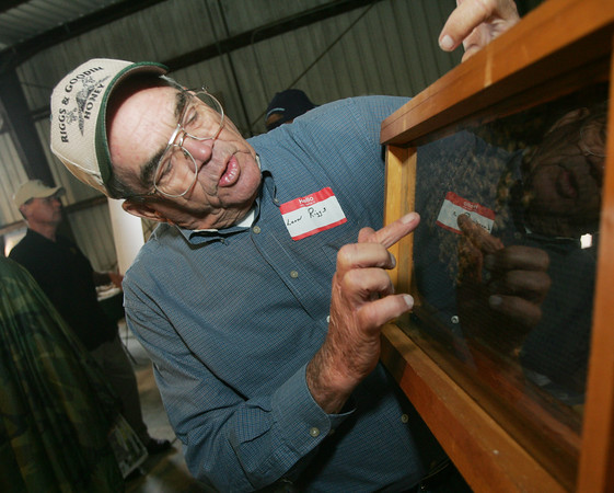 Globe/Roger Nomer<br /> Leon Riggs, with the Southern Missouri Beekeepers in Monett, talks about a bee hive during Ag Days at the Southwest Center on Friday.