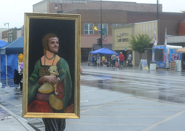 "Globe/Roger Nomer<br /> Bret Crockett walks through Little Balkans Days as da Vinci's ""Lady with an Ermine"" portrait on Saturday morning.  Crockett is part of the Pittsburg Entertainment and Artists Cooperative Endeavor."