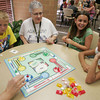 Globe/Roger Nomer<br /> (from left) Micah Bruggeman, Mariette Tarantino, Ilia Williams and Ashley Cormican play a game of Sorry on Tuesday afternoon at Messenger Towers.  Columbia Elementary fourth graders paid a visit to Tower residents during a service event for Patriot Day.
