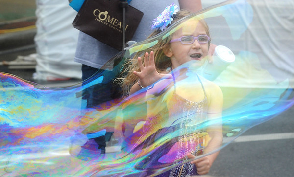 Globe/Roger Nomer<br /> Emily Craig, 5, Pittsburg, chases after a bubble while visiting downtown Pittsburg for Little Balkans Days on Saturday morning.