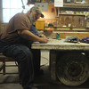 Globe/Roger Nomer<br /> Ray Mitchem works builds a reverse mold out of clay at WF Norman Corporation on Thursday.