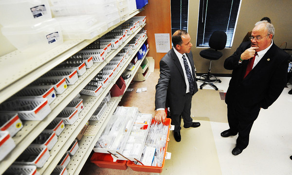 Globe/T. Rob Brown<br /> Senior Care Pharmacy Executive Director David de'Venau, center, shows Rep. Billy Long how emergency medications are stored and organized during Long's tour of the South Joplin facility Thursday afternoon, Sept. 27, 2012.