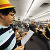 "Globe/T. Rob Brown<br /> Tournament co-judge Denny Andonov, left, of Carl Junction, calls off names as a pre-release ""Return to Ravnica"" tournament begins for the collectible card game ""Magic: The Gathering"" Saturday afternoon, Sept. 29, 2012, at Changing Hands Book Shoppe in Joplin. The store had about 35 players in attendance for each of its Saturday tournaments (about 70 total). Pre-release events were also held over the weekend at Hurley's Heroes Comics & Games on Main Street and Vintage Stock at Northpark Mall in Joplin. Changing Hands' third pre-release tournament will be held at noon Sunday and Hurley's Heroes will host another at 4 p.m. Sunday."