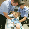 Globe/Roger Nomer<br /> Nick Hinkle, left, and Tony Surratt practice placing an IV during a paramedic class at Crowder College on Thursday.