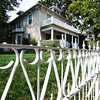 Globe/T. Rob Brown<br /> A white metal fence surrounds a home in the Murphysburg Residential Historic District at the corner of 3rd and South Seargent Tuesday afternoon, Sept. 25, 2012.