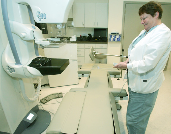 Globe/Roger Nomer<br /> Nancy Bettasso, director of hospital based clinics for Mercy, looks at a duel digital machine for mammography and  stereotactic biopsy at Mercy's new Breast Cancer Center.