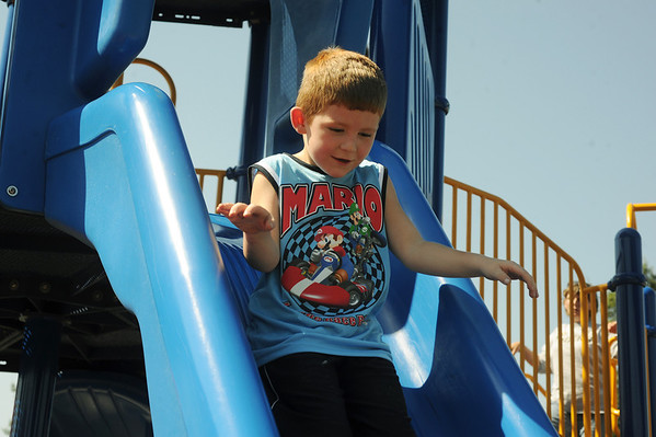Globe/Roger Nomer<br /> Trey Friend, 4, Joplin, plays on a slide at Schifferdecker Park on Thursday afternoon.
