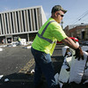 Globe/Roger Nomer<br /> Jeff Buchanan, with the Joplin Special Road District, helps clear debris from the roof of the Jasper County Courts Building on Wednesday morning.
