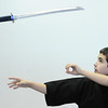 "Globe/T. Rob Brown<br /> Riley ""Rye"" Capen, left, 12, a second-degree blackbelt in Taekwondo, flips his sword through the air Wednesday, Sept. 26, 2012, at the Team Victory Martial Arts dojo in Joplin."