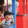 Globe/Roger Nomer<br /> Cole Stolte, 2, Overland Park, gives a thumbs up as he departs on the Sunshine Express train ride through downtown Pittsburg on Saturday.  Stolte's grandfather drove the train for the Little Balkans Days celebration.