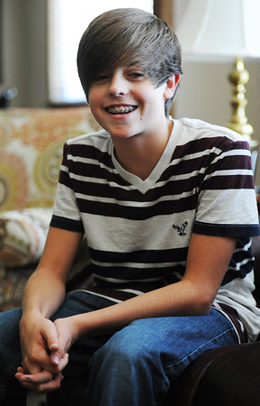 Globe/T. Rob Brown<br /> Grant Landis, 13, of Joplin, has recorded and co-written several pop songs recently.