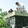 Globe/Roger Nomer<br /> Michael Rosati, left, a volunteer from Pinckney, Mich., and Eric Talbert, an intern with EF Joplin, smooth concrete on the roof of Dawn Brazelton's shelter in July.