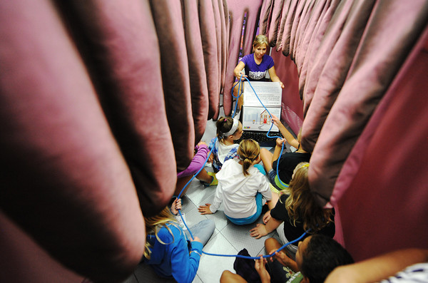 Globe/T. Rob Brown<br /> Lakeside Elementary School students tour Body Venture, a touring educational tool, as volunteer Joanna Rhodes, of Pittsburg, Kan., speaks about the intestines Wednesday afternoon, Sept. 12, 2012, in the Pittsburg school's gymnasium.