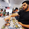"Globe/T. Rob Brown<br /> Player Clayton Palmer, right, of Joplin, builds his card deck during the start of a pre-release ""Return to Ravnica"" tournament for the collectible card game ""Magic: The Gathering"" Saturday afternoon, Sept. 29, 2012, at Changing Hands Book Shoppe in Joplin. The store had about 35 players in attendance for each of its Saturday tournaments (about 70 total). Pre-release events were also held over the weekend at Hurley's Heroes Comics & Games on Main Street and Vintage Stock at Northpark Mall in Joplin. Changing Hands' third pre-release tournament will be held at noon Sunday and Hurley's Heroes will host another at 4 p.m. Sunday."