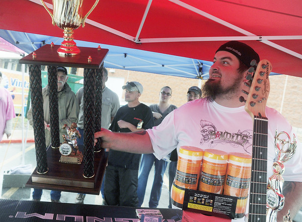 Globe/Roger Nomer<br /> Jeff Daugherty awards the first place trophy at the first annual Bandits Poker Run and Car Show at Northpark Mall on Saturday afternoon.  The event raised over $200 for the Joplin Boys and Girls Club.