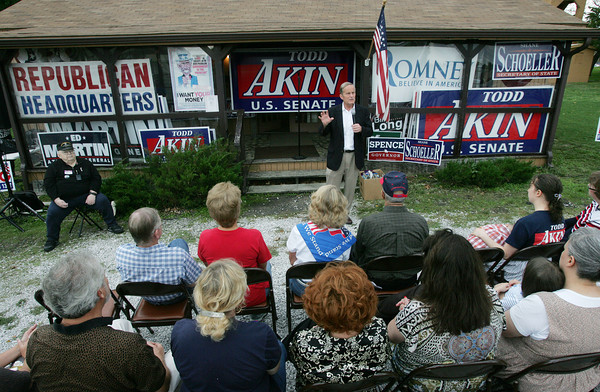 Globe/Roger Nomer<br /> Rep. Todd Akin talks with supporters during a visit to Jasper County Republican Headquarters on Wednesday morning.