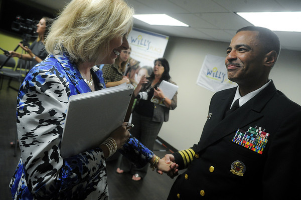 Globe/Roger Nomer<br /> Paula Baker, president and CEO of Freeman Health Systems, talks with Captain Jose Belardo, Regional Health Administrator for the U.S. Department of Health and Human Services, following Monday's press conference at Will's Place.