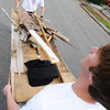 Globe/T. Rob Brown<br /> Nathan Jordan, left, of Joplin, and Michael Judd, an Ozark Christian College junior psychology counseling major from Blue Springs, carry a load of yard and other debris on Wall Avenue to a nearby dumpster Sunday morning, Sept. 30, 2012, during the Great Day of Service in Joplin.